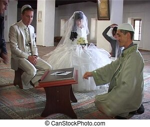 Islamic wedding ceremony in mosque Nikah - relatives signed...