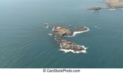 Island aerial - Aerial of an small Island at the coast of...