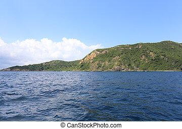 Island and blue sky on a fine weather. - Island and blue sky...