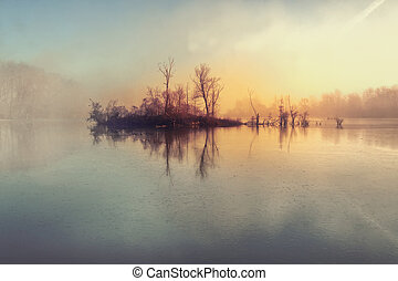 Island and mysterious fog over river