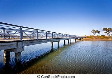 Island Bridge - A bridge spans across the water leading to...
