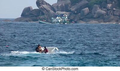 Island. - Boats near island.