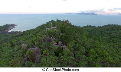 Island forest and ocean aerial shot