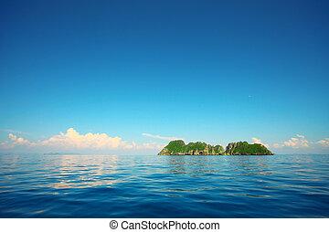 Island in sea - Tropical island in a blue sea and blue sky
