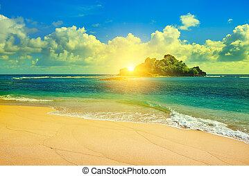 Island in the ocean and beautiful sunrise
