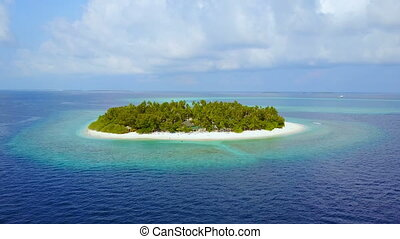 Island in the sea. Maldives white sand beach tropical islands with drone aerial flying birds eye view with aqua blue sea water and sunny sky