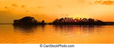 Island in the twillight - Islands in the lake with sun set