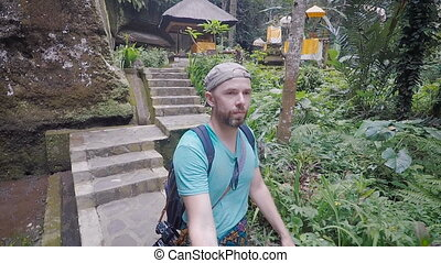 Island of Bali. An excursion on the island. The person in a...