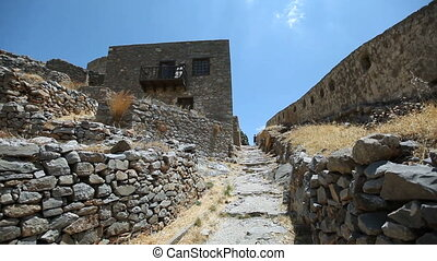 Island of Spinalonga in Crete Greece landmark. Ruins of an...
