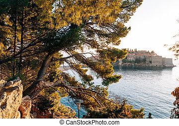 Island of Sveti Stefan close up at sunset. Montenegro, the...