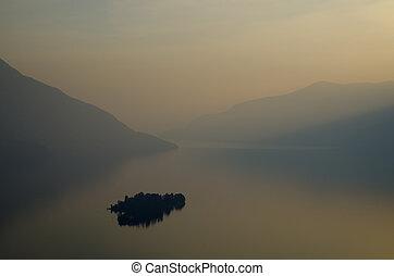 Island on a lake with mountain