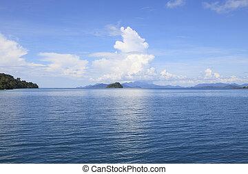 island on beautiful sea scene against sunny and cloudy day use a