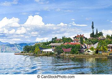 Island Samosir, Lake Toba. Sumatra - Village Tuk tuk. Island...