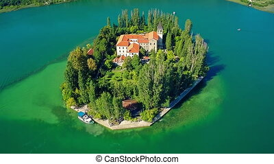 Island Visovac, aerial ascent shot