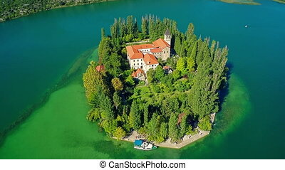 Island Visovac, aerial descenting shot - Copter aerial view...