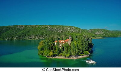 Island Visovac boat leaving - Copter aerial view of the...