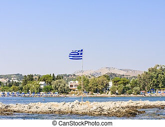 Island with a Greek flag. The resort of Faliraki. Rhodes Island.
