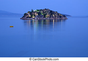 Island with church in a sea. Evening.
