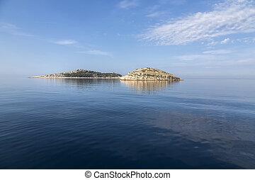 Island with lighthouse in National Park Kornati, Croatia.