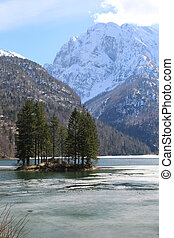alpine lake called Lago del Predil in Northern Italy -...