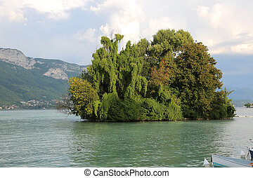 island with trees on the lake in Annecy City in France