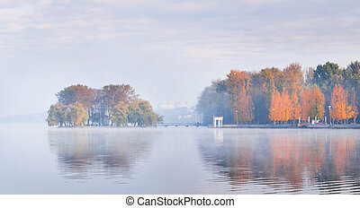 islet on the lake in city in autumn
