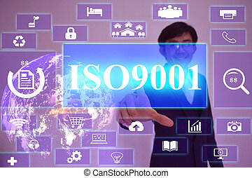 ISO9001 concept  presented by  businessman touching on  virtual  screen ,image element furnished by NASA