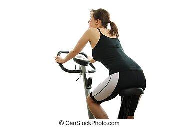isolé, jeune femme, équitation, sur, a, rotation, vélo