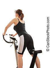 isolé, jeune femme, debout, sur, a, rotation, vélo