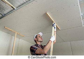 isolé, plafond, brillant, aluminium, bricolage, foil., cadre, travail, ouvrier, jeune, vous-même, bois, protection, gants, suspendu, fixation, il, supports, métal, drywall, concept.