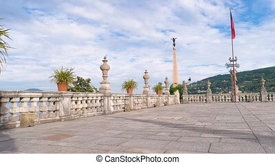 Isola Bella panoramic view, summer. Baroque balustrade with...