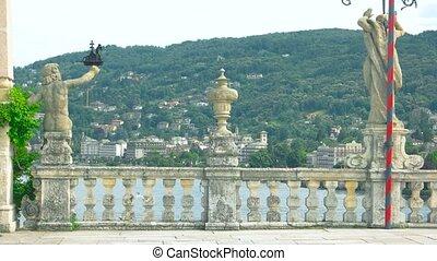 Isola Bella statues. Old baroque sculptures outdoor.