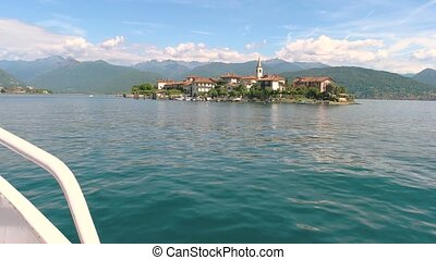 Isola Superiore and cloudy sky. View from tourist boat,...