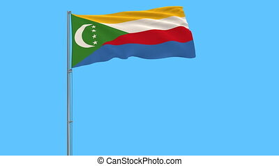 Isolate flag of Comoros on a flagpole fluttering in the wind on a blue background, 3d rendering