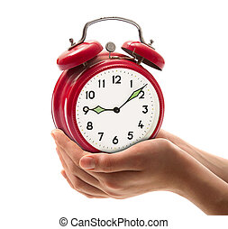 alarm clock held in hand on white background