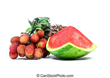 Isolated arrangement of fruit, watermelon, pineapple and lychees.