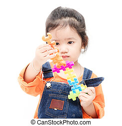 Isolated asian kid girl playing with toys