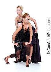 blond and brunette women posing