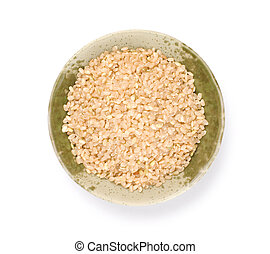 Isolated brown rice in bowl