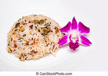 isolated brown rice with the purple orchid beside for decoration on white background.