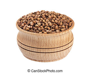 Isolated buckwheat seeds. Wooden bowl with buckwheat groats on white background. Close-up