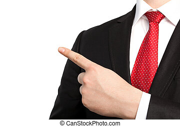 Isolated businessman in a suit and red tie points the finger at an object