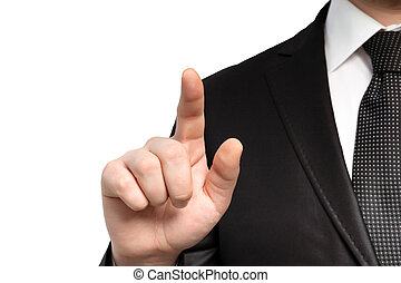 Isolated businessman in a suit and tie points the finger at an object