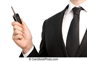 Isolated businessman in suit holding a car key