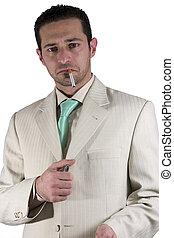 Businessman lighting up a cigarette