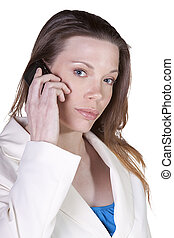 Businesswoman at Talking on the Cell Phone at Work