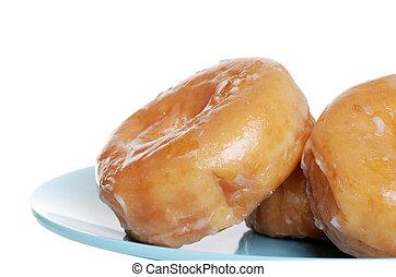 closeup of glazed donuts