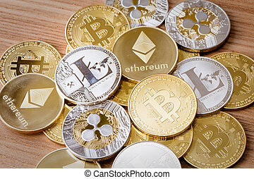 A group of crypto currency coins including Bitcoin, Litecoin, Ripple and Ethereum on an isolated background