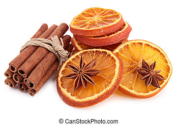 isolated dried orange slices and cinnamon