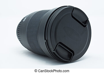Isolated DSLR camera lens with cover on.